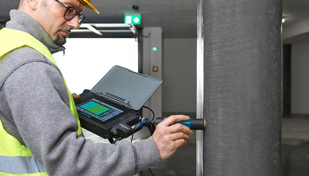 A Man is Performing Half-Cell Corrosion Mapping